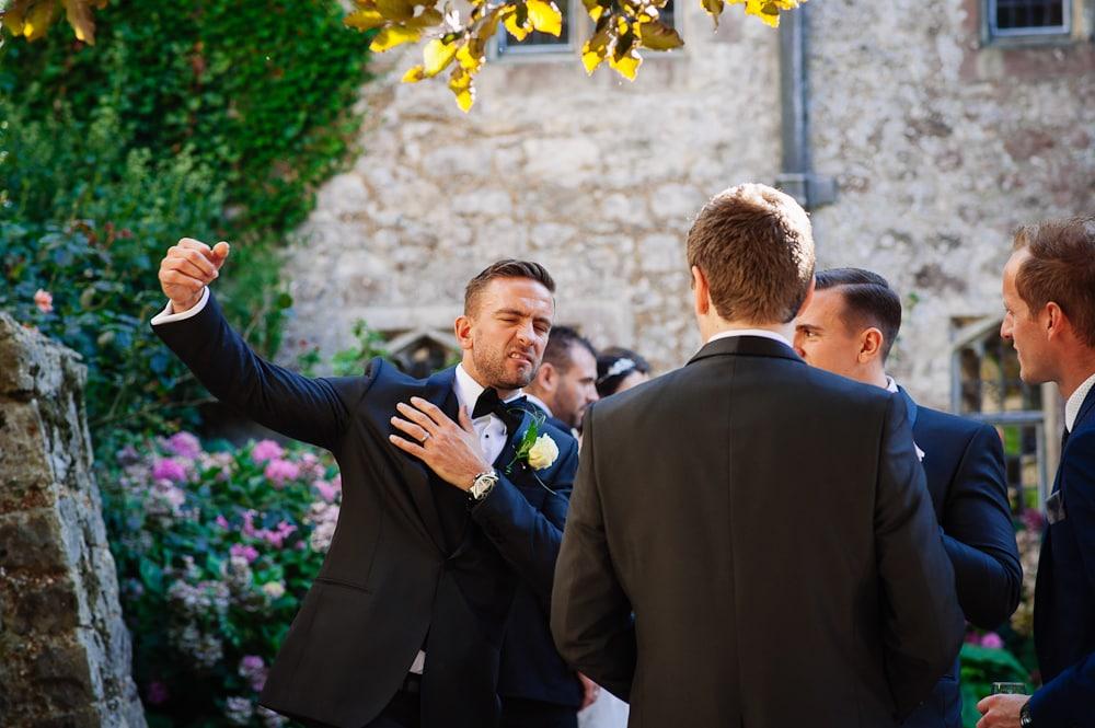groom flexing arm