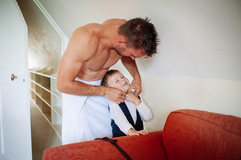 groom prep getting son ready