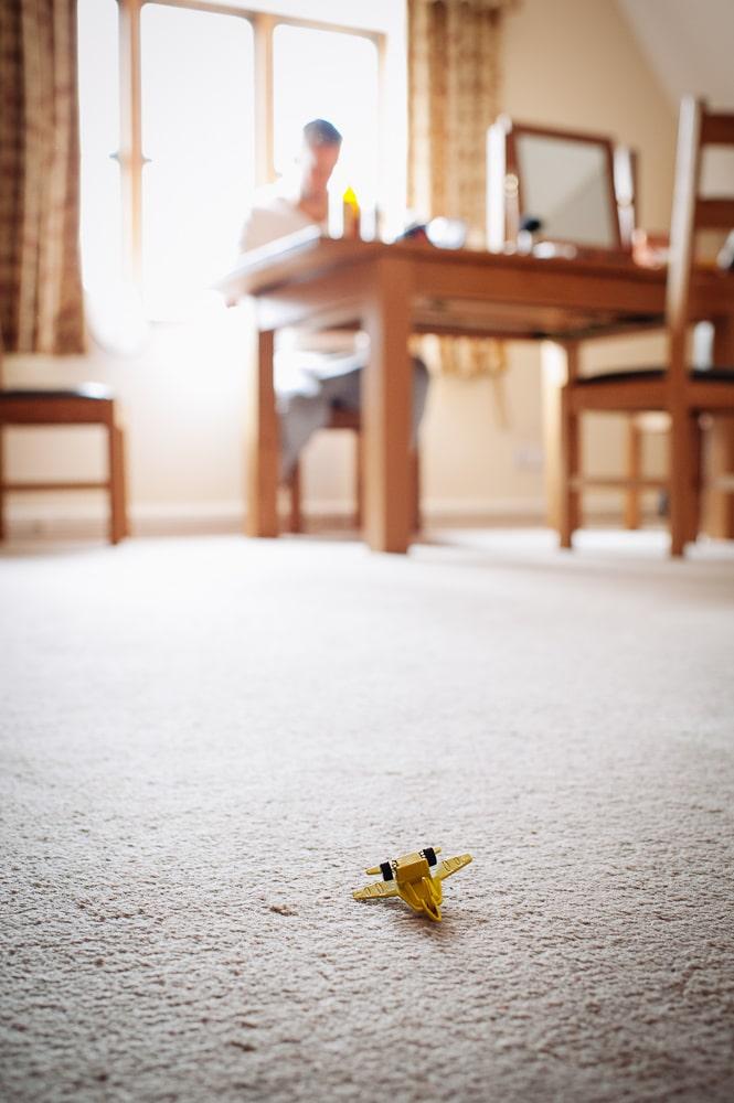 yellow toy plane on floor
