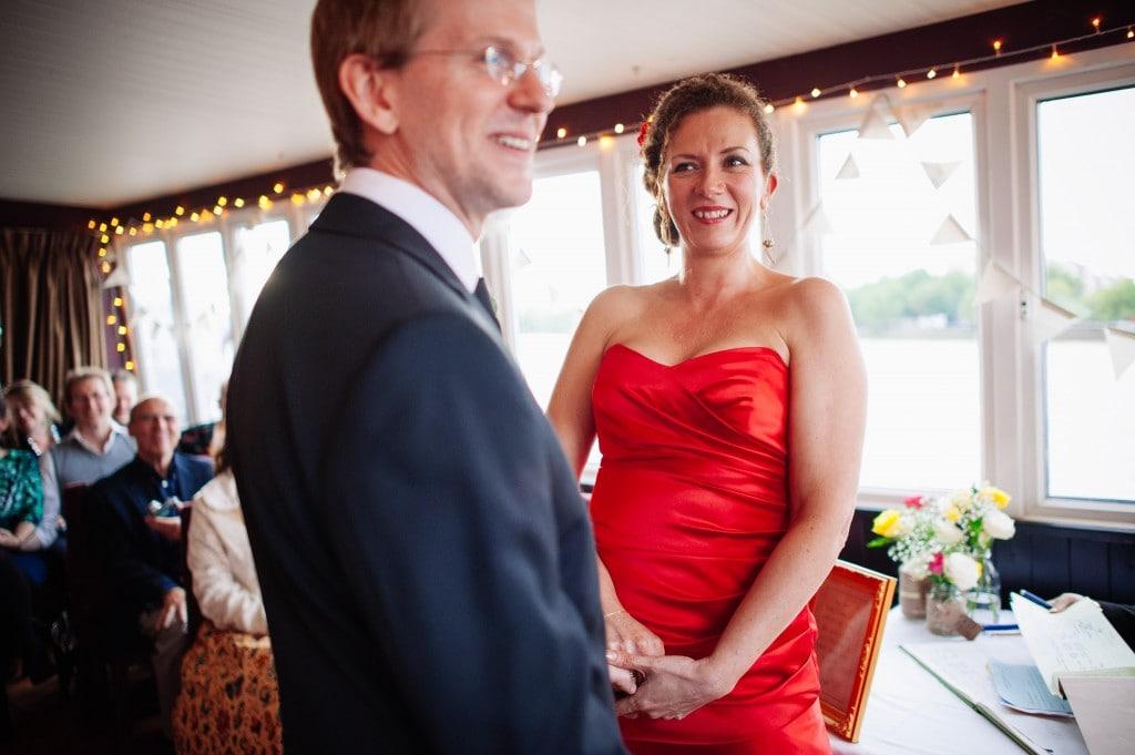 bride in red dress looking at groom