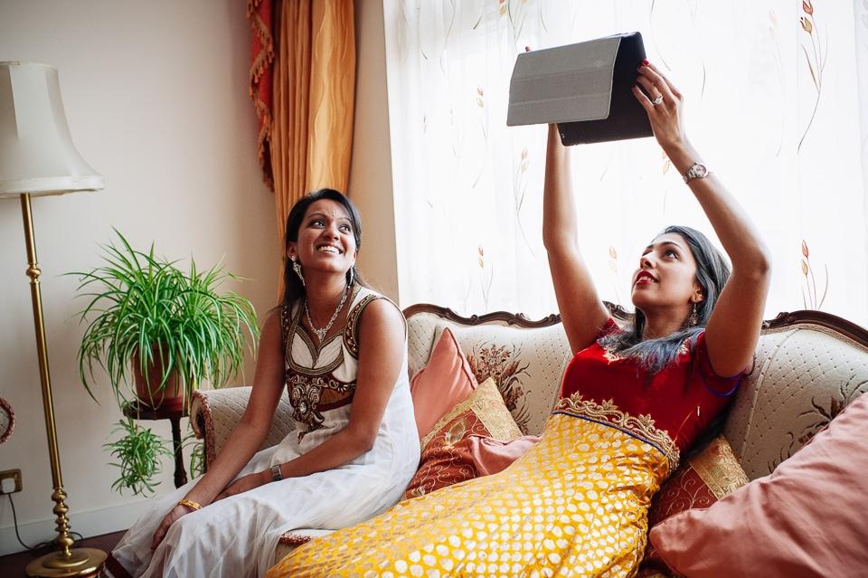 girls taking photo on ipad