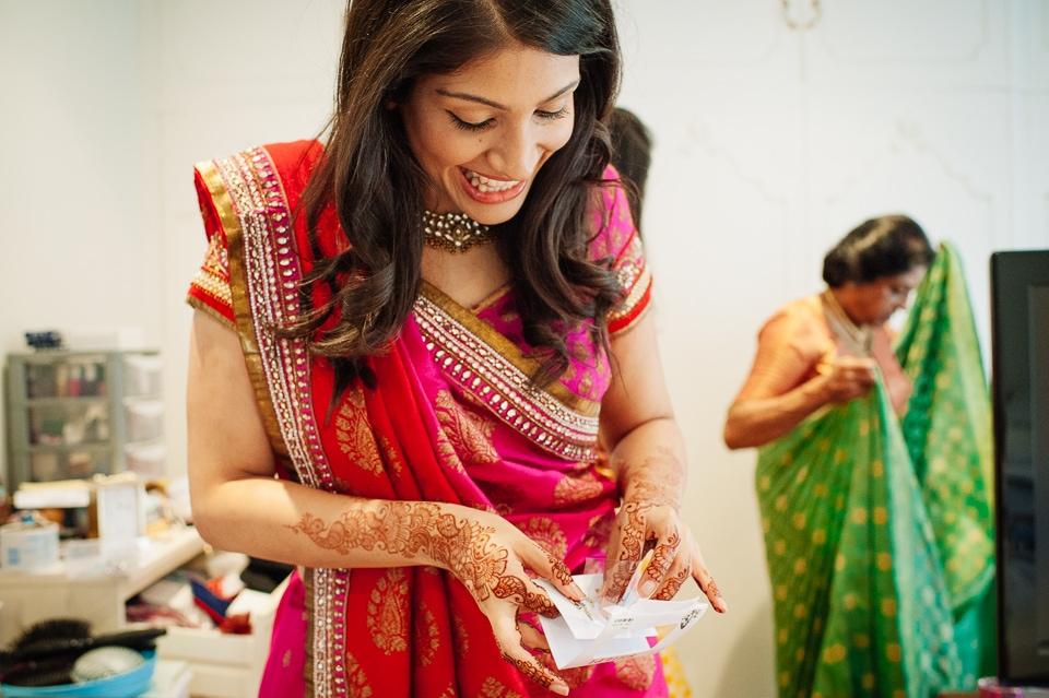 bride putting on her bindi