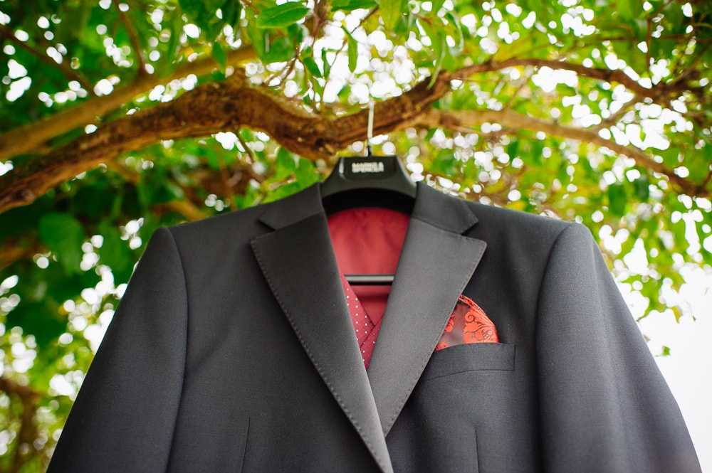 suit hanging in tree