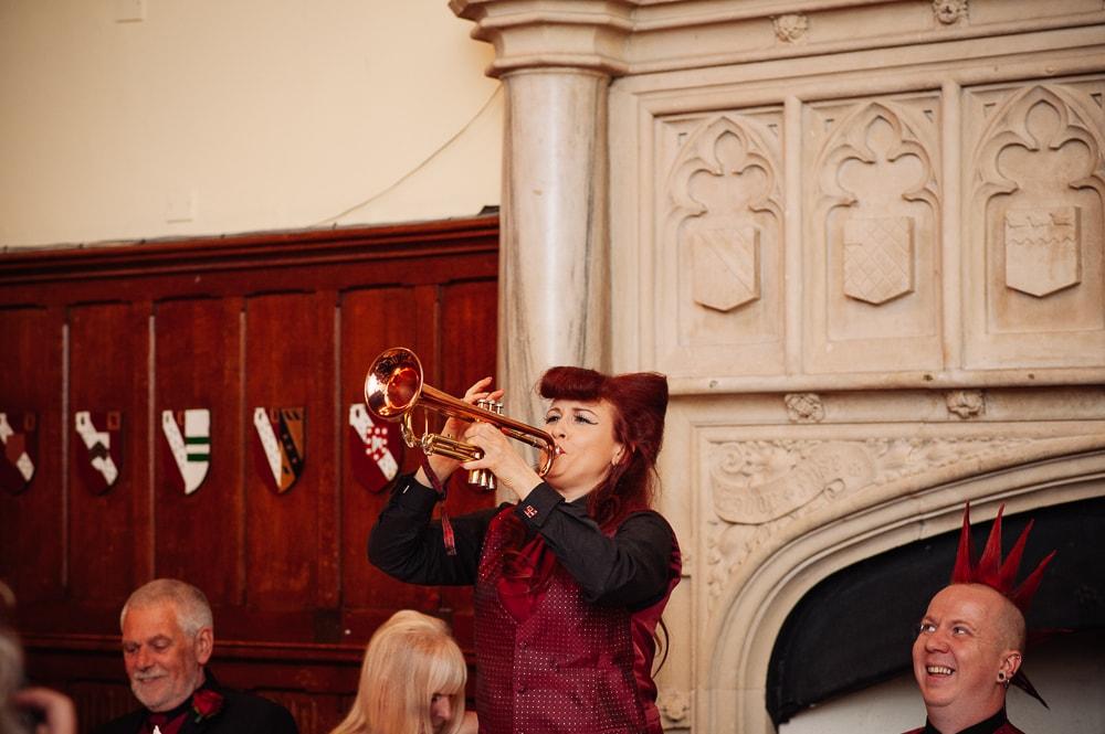 blowing trumpet during best man speech