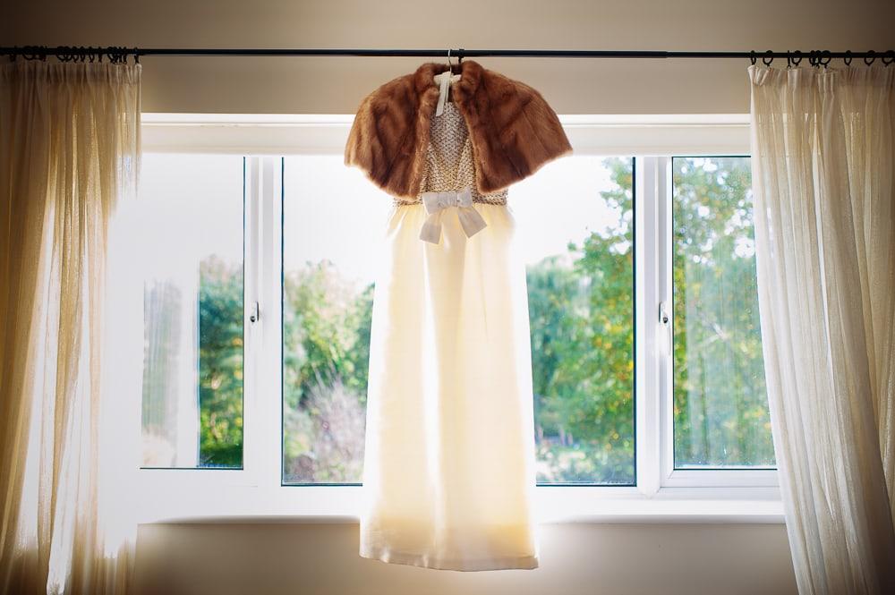 fur bolero and vintage gold wedding dress bow