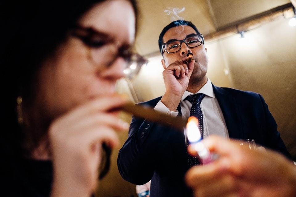 candid photo of cigar smoking