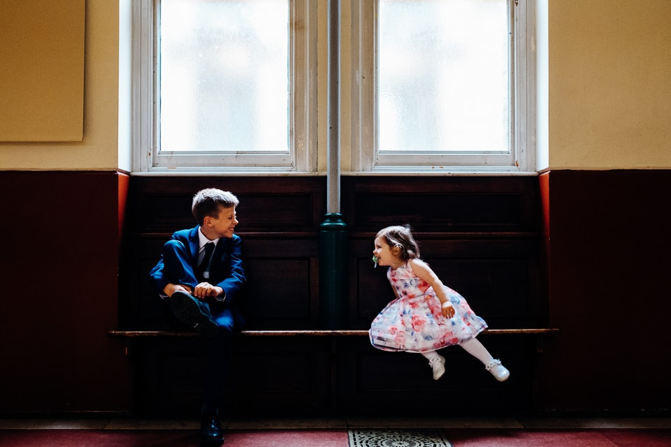 a mirrored image of two children at hackney round chapel