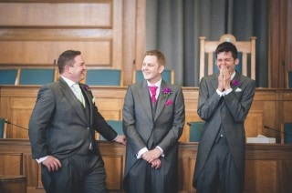 Groom joking with groomsmen London Alternative Candid Relaxed Fun Alternative Documentary Wedding Fanham Hall Photography