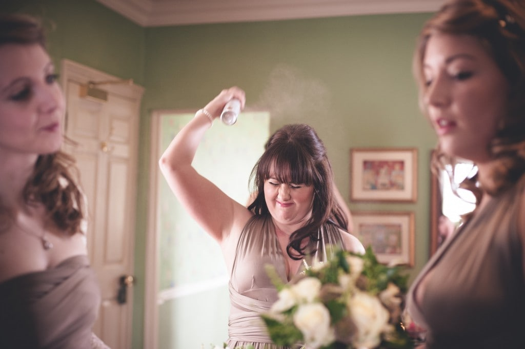 bridesmaid spraying hair London Alternative Candid Relaxed Fun Alternative Documentary Wedding Photography