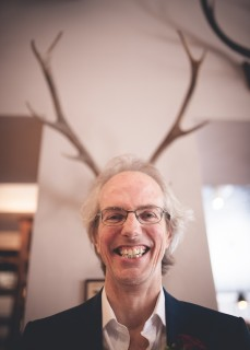 quirky funny relaxed groom portrait stag antlers